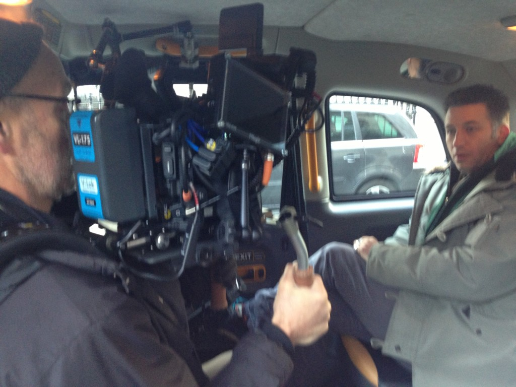 Optomen cameraman Steve and presenter Remy as they film footage inside one of our London Black Taxis