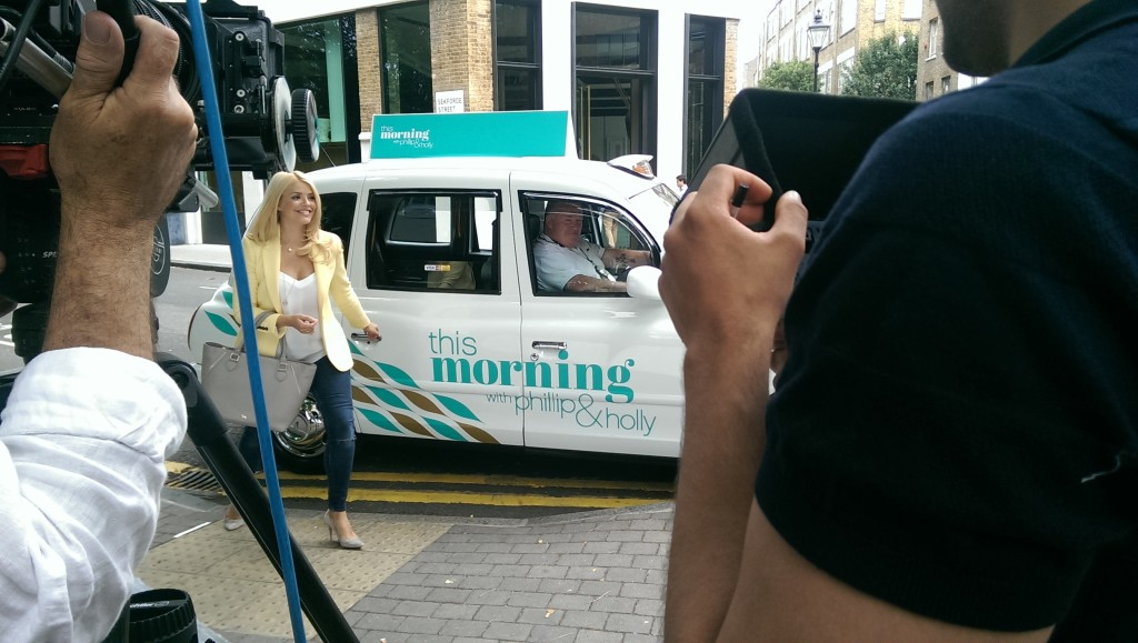 Our taxi being filmed with ITV This Morning show