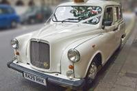 Classic White Fairway Taxi